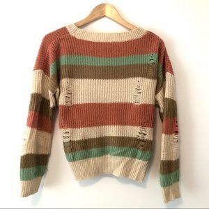 Cozy warm colored Striped distressed sweater